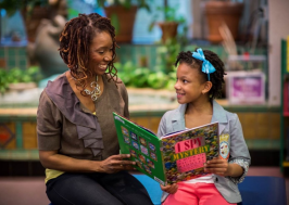Librarian reading with young girl